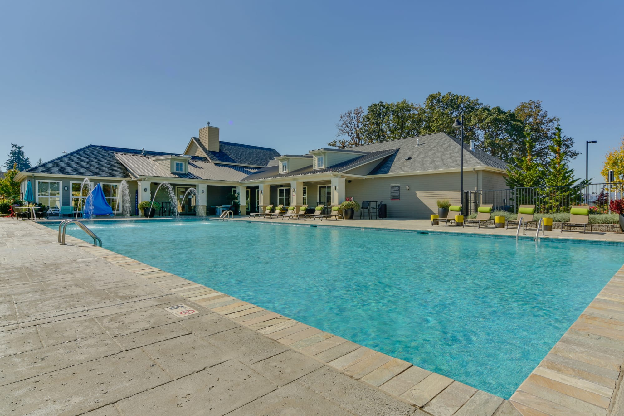 The large, sparkling swimming pool and clubhouse at Terrene at the Grove in Wilsonville, Oregon