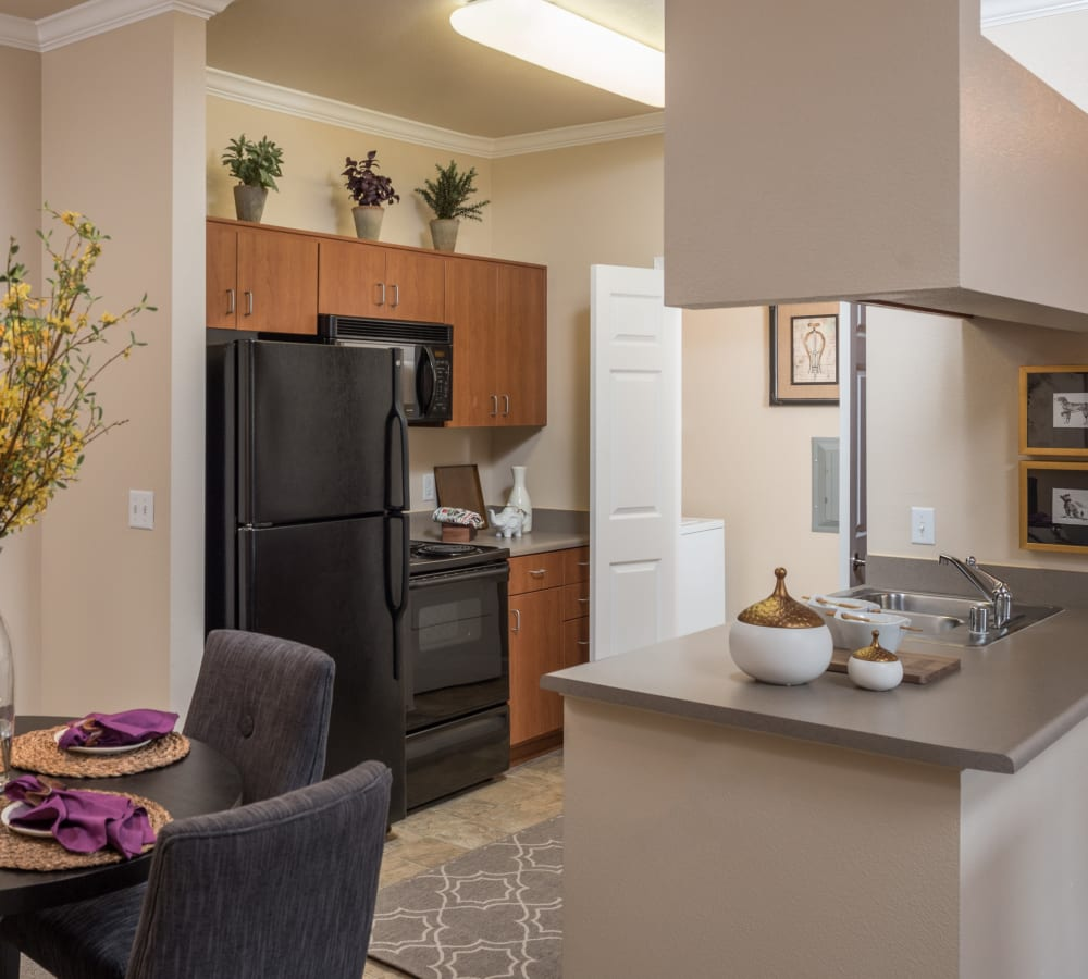 Kitchen with black appliances at Esplanade Apartment Homes in Riverside, California