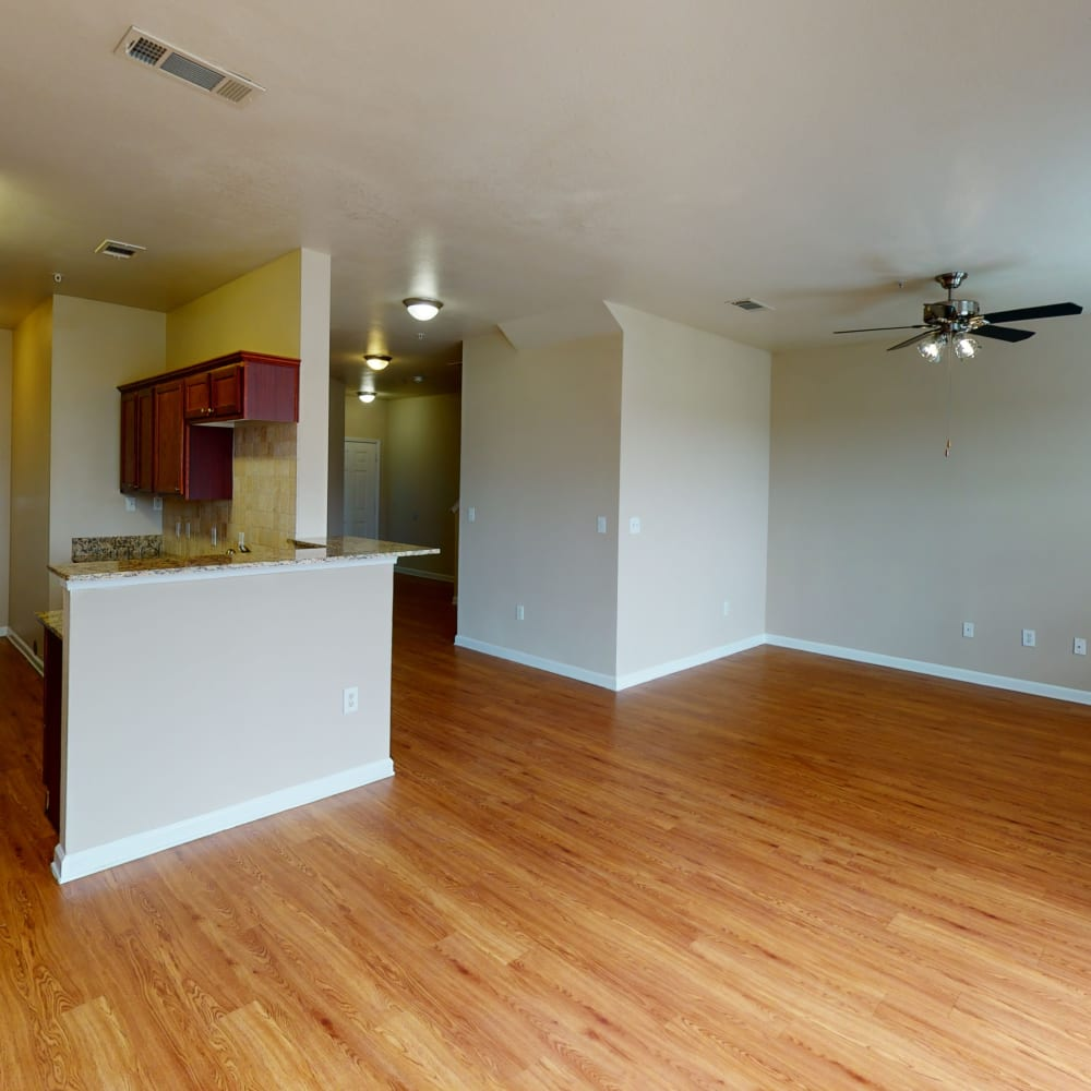 Beautiful hardwood flooring in the living areas of a townhome at Oaks Estates of Coppell in Coppell, Texas