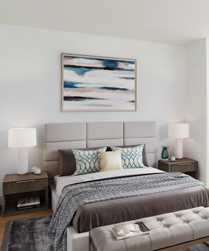 A modern bedroom with wood-style flooring at The Metropolis in New York, New York