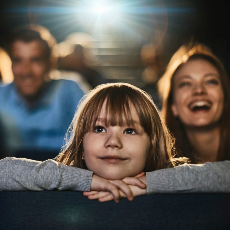 Family enjoying a movie in the cinema near 23Hundred at Ridgeview in Plano, Texas
