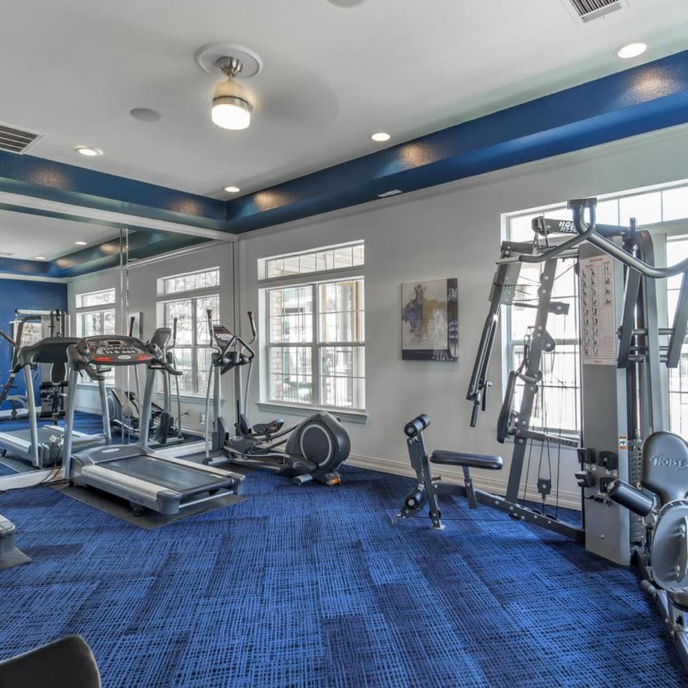 Fitness center with individual work stations at Ranch at Hudson Xing in McKinney, Texas