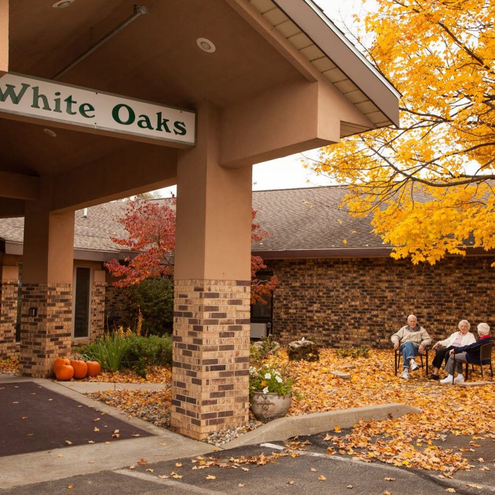 Residents sitting outside in the fall at White Oaks in Lawton, Michigan