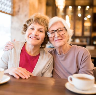 Two resident friends getting coffee at Mirror Lake Village Senior Living Community in Federal Way, Washington.