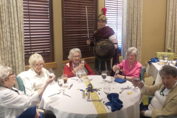 Residents enjoying a nice meal at event at All Seasons of Birmingham in Birmingham, Michigan