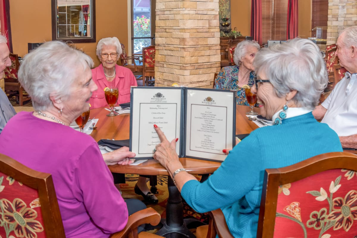 Resident choosing from a menu at Watercrest at Mansfield in Mansfield, Texas