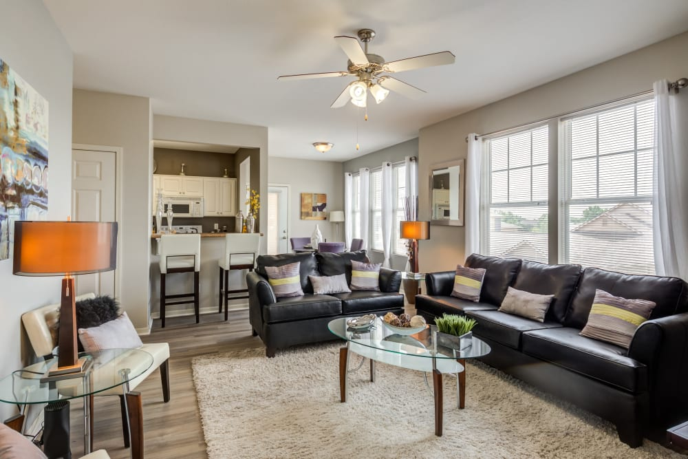 Spacious layout with wood-style flooring at Alvadora Apartments in Lawrence, Kansas
