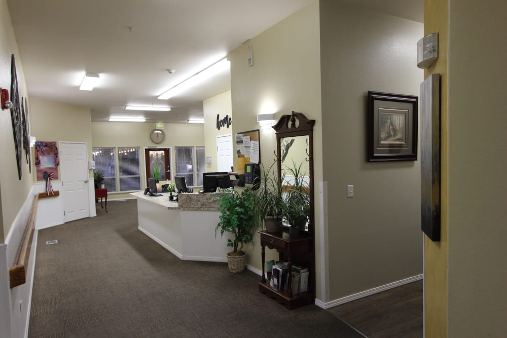 Reception desk and welcome area at The Willows Retirement & Assisted Living in Blackfoot, Idaho