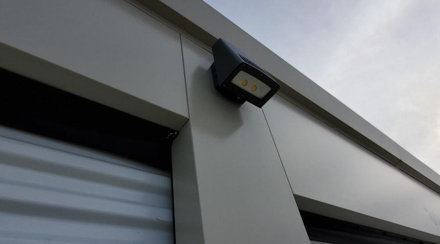 Motion-activated lighting outside storage units at KO Storage of Albert Lea in Albert Lea, Minnesota