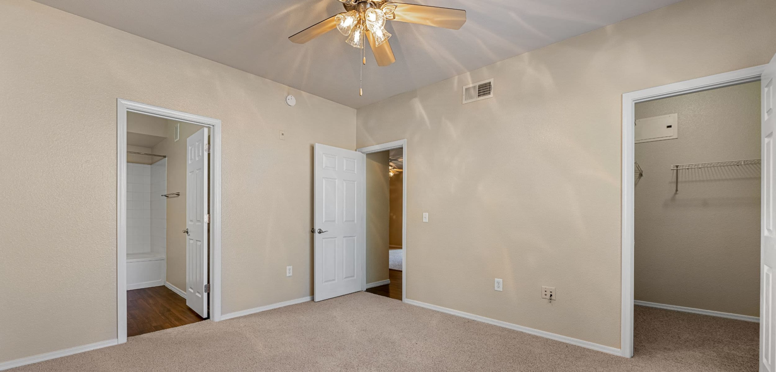 Bedroom with ceiling fan at Azure Creek in Cave Creek, Arizona