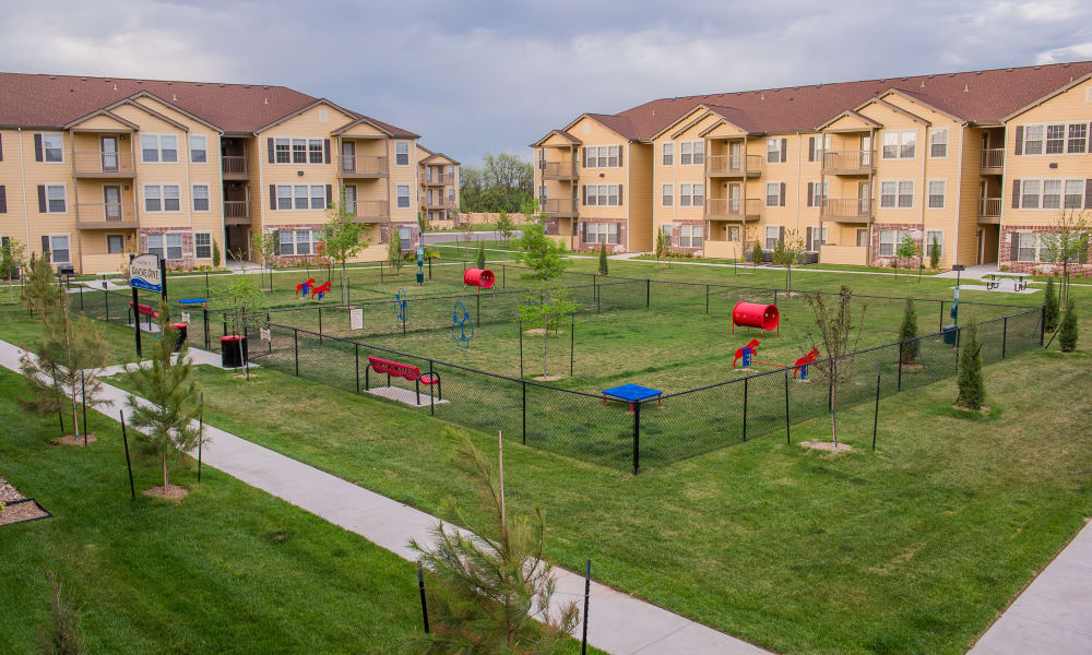 Large outdoor dog park at Watercress Apartments in Maize, Kansas
