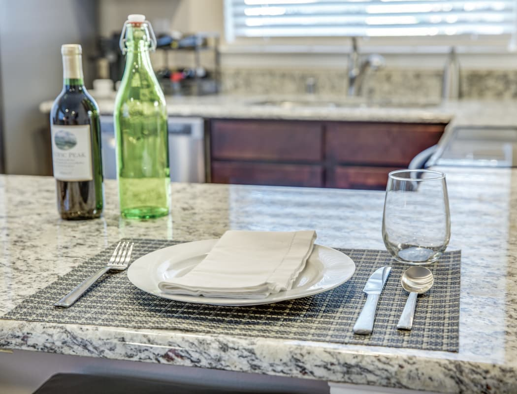 Avilla Northside showcases a beautiful kitchen with breakfast bar in McKinney, Texas