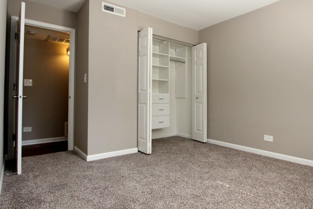 Bedroom with spacious closets at Cypress Place in Elk Grove Village, Illinois.