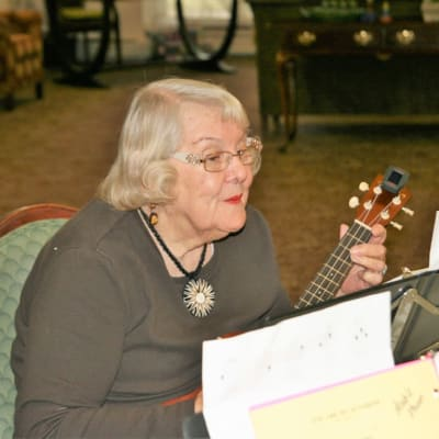 Resident playing music at Ebenezer Ridges Campus in Burnsville, Minnesota