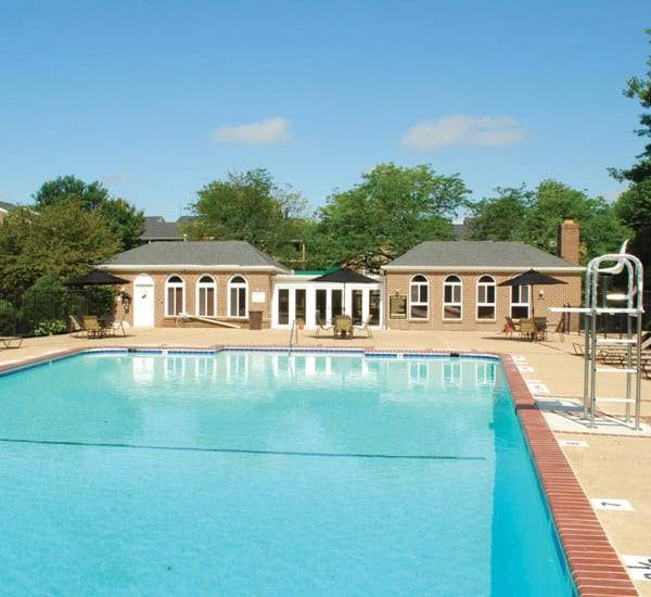 Resort-style swimming pool at East Meadow Apartments in Fairfax, Virginia