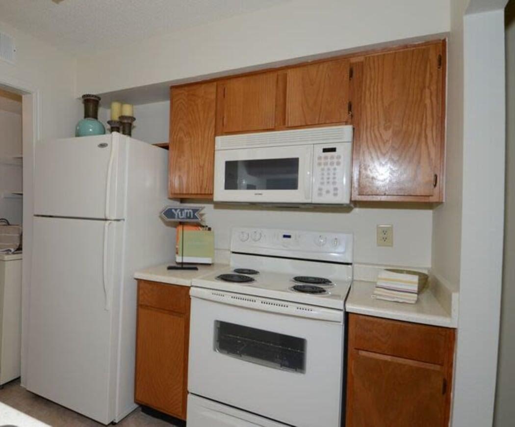 Kitchen with white appliances at Newport Apartments in Amarillo, Texas