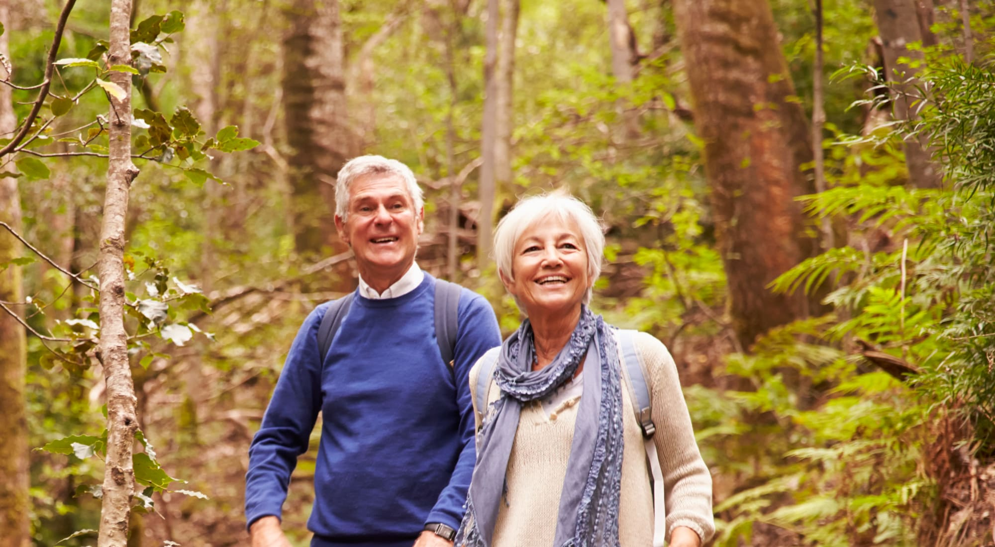 Residents out on a wooded hike near Lassen House Senior Living