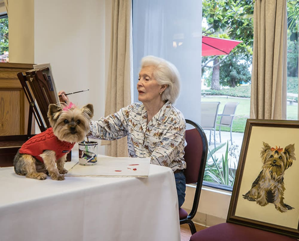 Resident painting with her dog at Pasadena Highlands in Pasadena, California