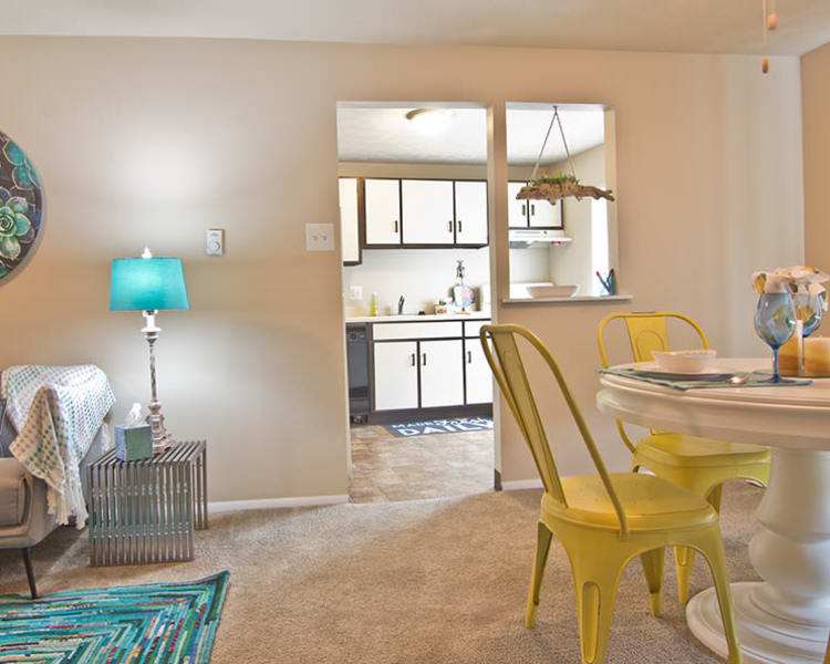 Living room, dining area and kitchen at Park Place of South Park