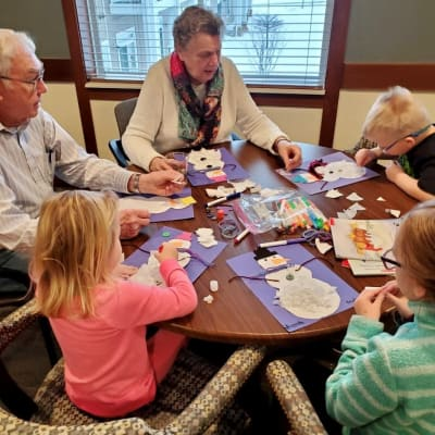 Residents make arts and crafts at an intergenerational activity at Arbor Glen Senior Living in Lake Elmo, Minnesota