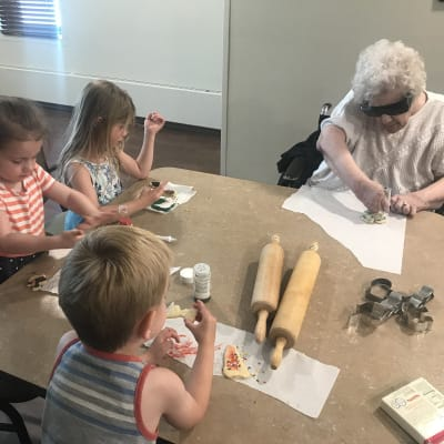 A resident and children making cookies at Ebenezer Ridges Campus in Burnsville, Minnesota