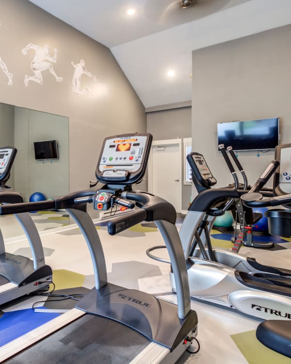 fitness center cardio machines and TV at Elan 41 Apartments in Seattle