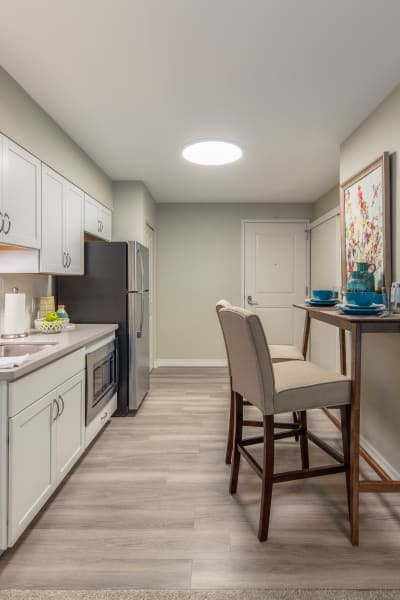 Modern senior apartment kitchen at Quail Park of Oro Valley in Oro Valley, Arizona