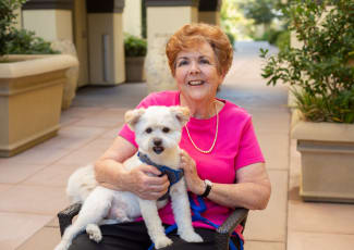 Resident with her dog at Campbell senior living