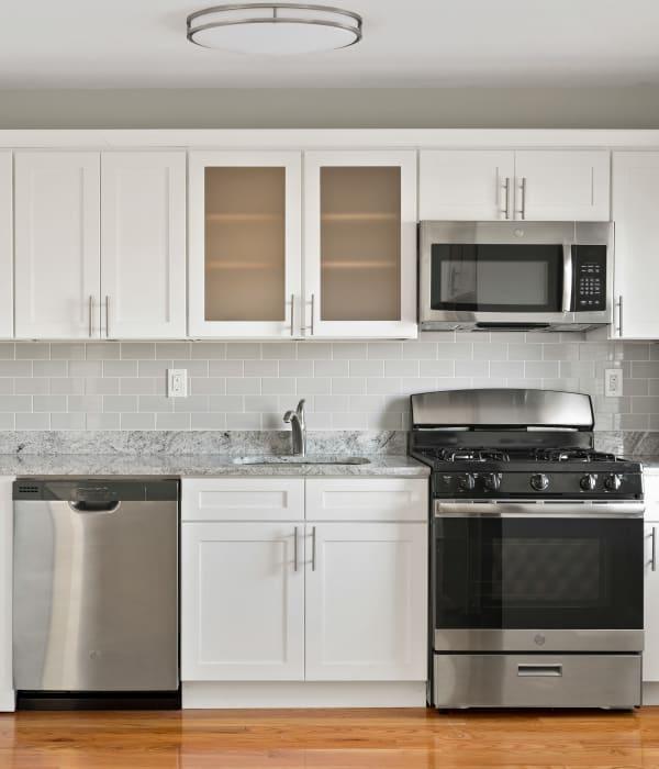 Sleek, modern kitchen at Eagle Rock Apartments at Huntington Station in Huntington Station, New York