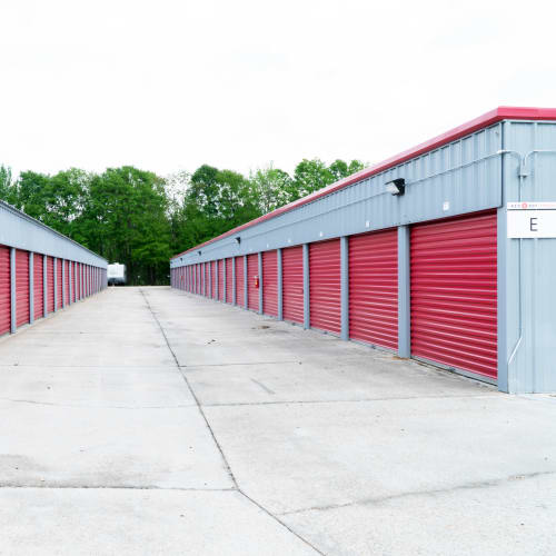 Row of outdoor storage units with red doors at Red Dot Storage in Denham Springs, Louisiana