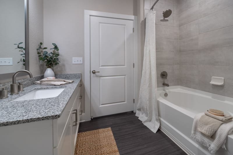 Roomy bathroom with lots of storage space under the large vanity at Reunion at 400 in Kissimmee, Florida