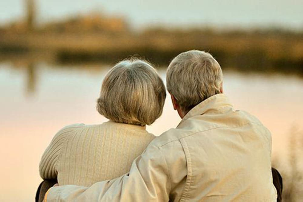 Senior couple looking at the lake near Peachtree Village Retirement Community