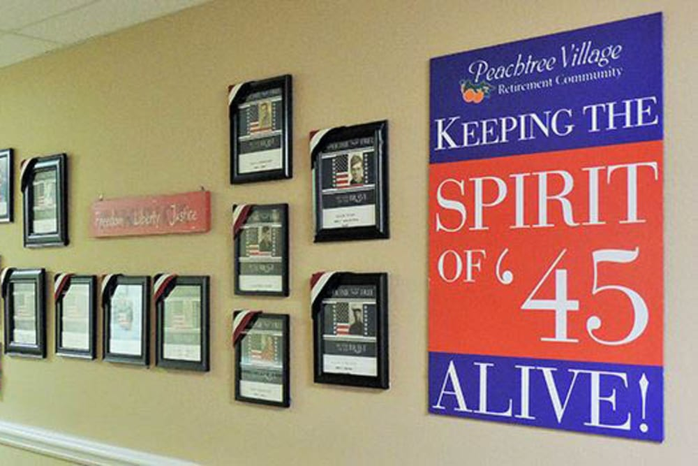 Signs and awards on the wall at senior living in Roswell, NM