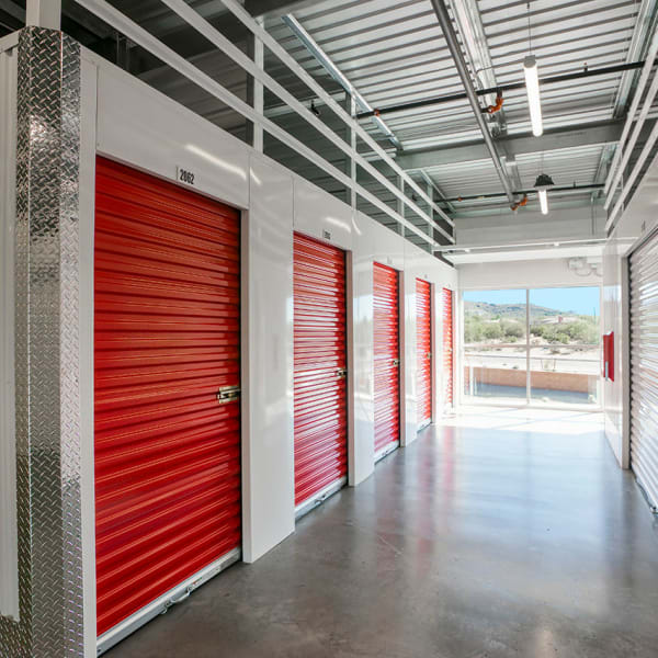 Indoor units with red doors at StorQuest Self Storage in Carefree, Arizona