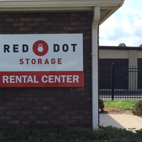 Outdoor storage units and rental center sign at Red Dot Storage in Terre Haute, Indiana