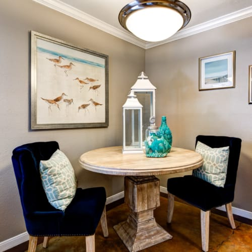 Dining table with chairs in corner with round light above at Austin Midtown in Austin, Texas