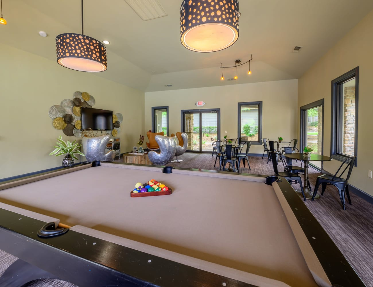 Resident clubhouse with billiards table and more at Artisan at Lake Wyndemere in The Woodlands, Texas
