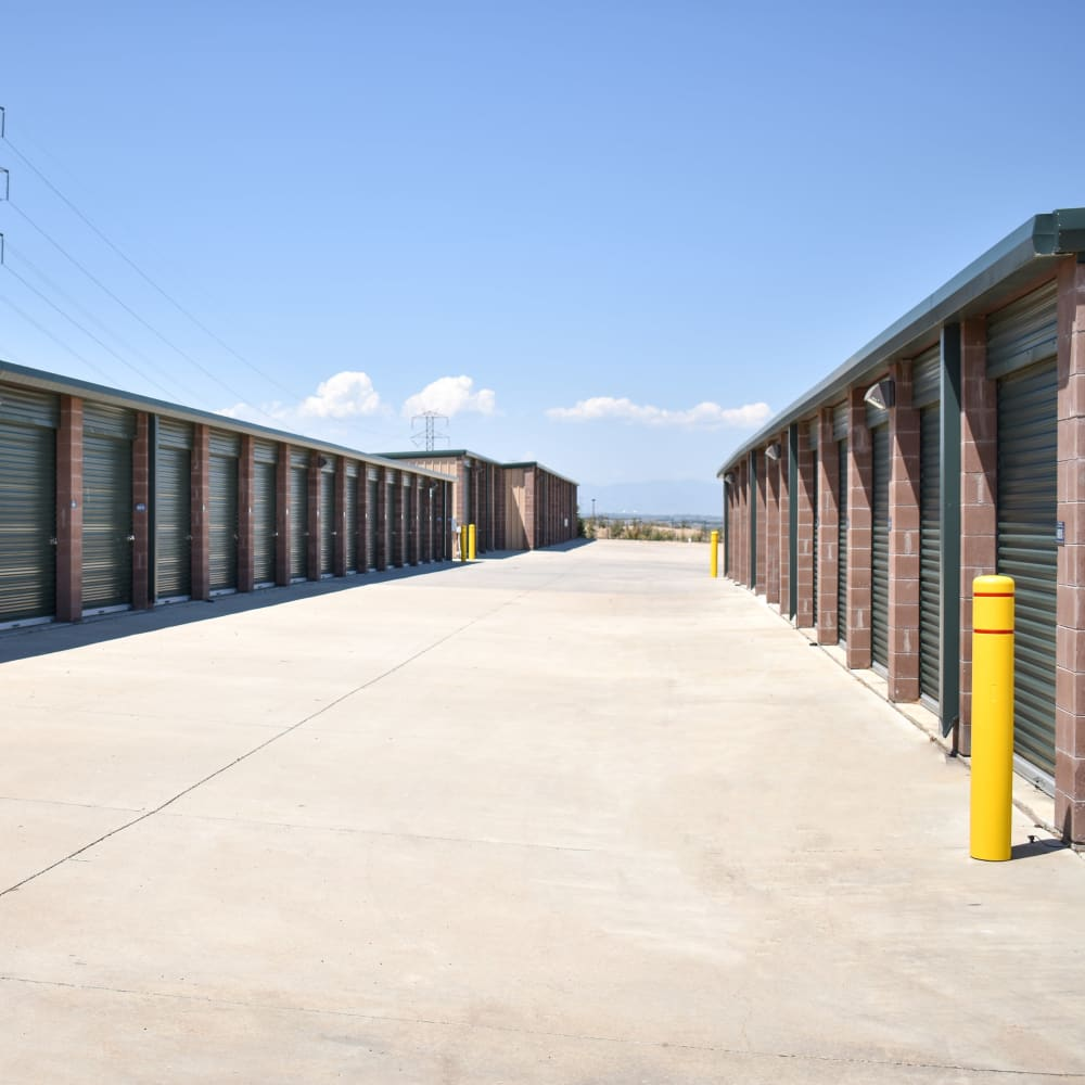 A wide driveway between rows of storage units at STOR-N-LOCK Self Storage in Henderson, Colorado