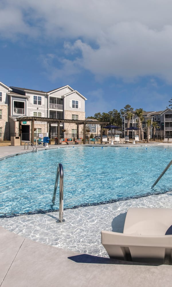 Gorgeous swimming pool and lounge area at South City Apartments in Summerville, South Carolina