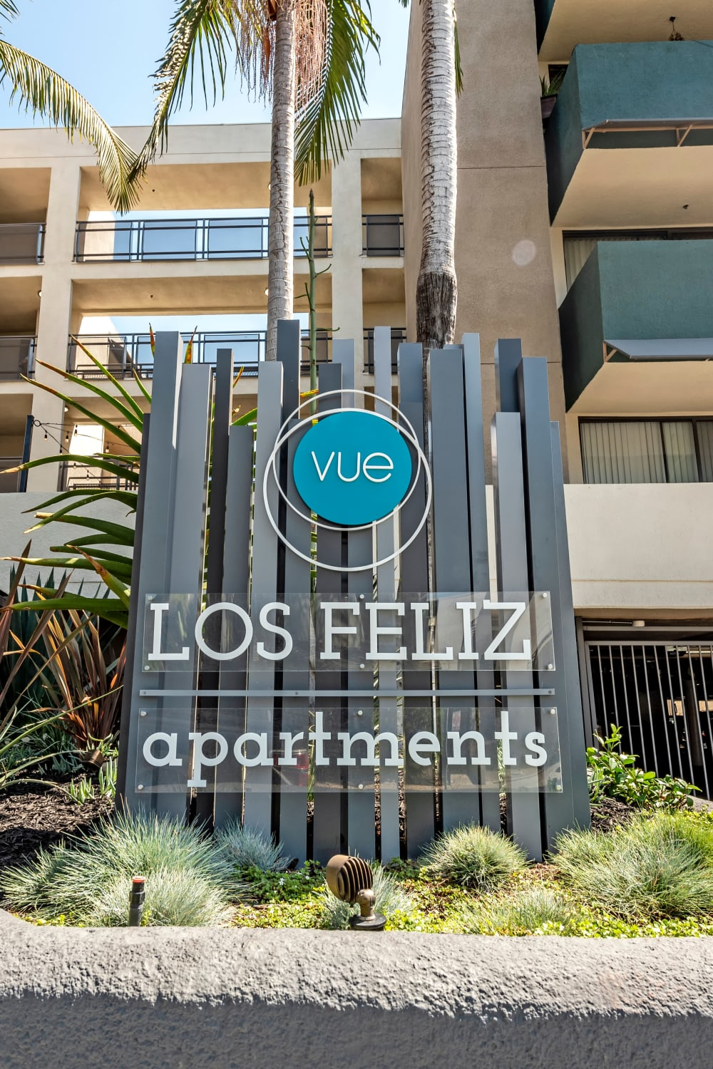 Exterior view of resident buildings with our sign out front at Vue Los Feliz in Los Angeles, California