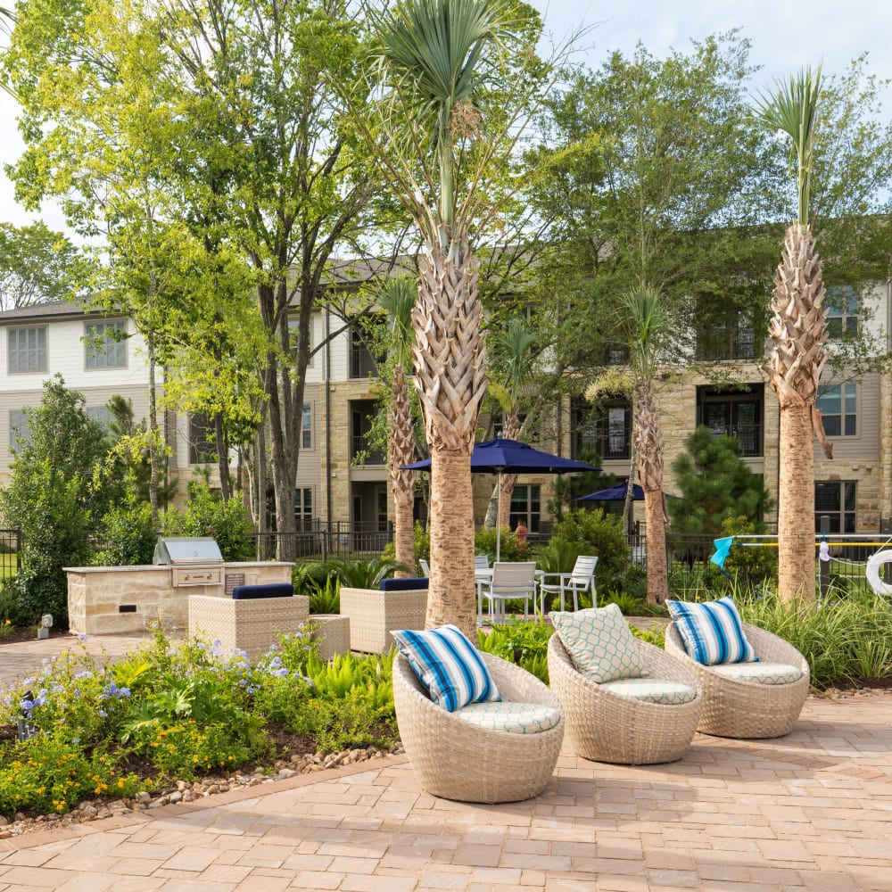 BBQ grills by the pool at Opal at Barker Cypress in Houston, Texas