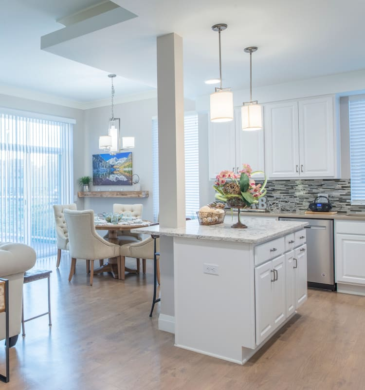 Modern kitchen and plenty of space in independent living home at Village at Belmar