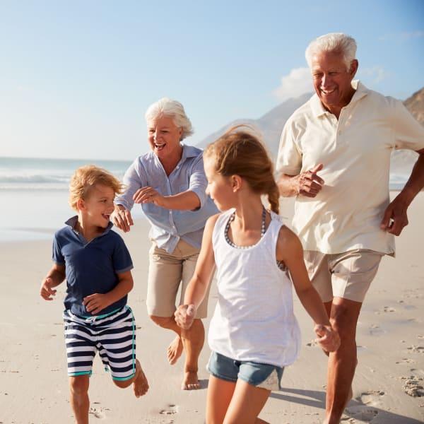 Resident grandparents and grandchildren playing on the beach near Town Lantana in Lantana, Florida