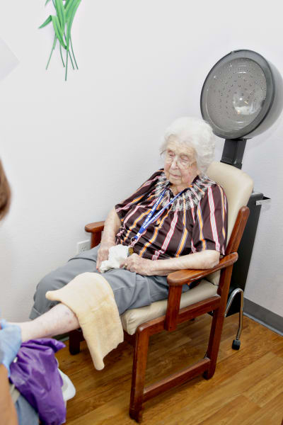 A resident is getting a pedicure at Providence Assisted Living in Springdale, Arkansas.