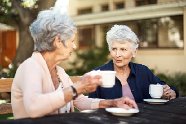 Residents of Regency Park Senior Living, Inc. communities having tea outside