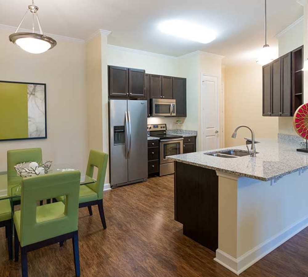 Kitchen with stainless steel appliances at Alaqua in Jacksonville, Florida