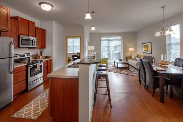 Kitchen and dining room layout at The West End Apartments in Verona, Wisconsin