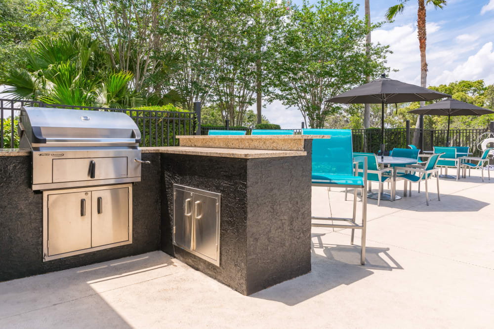 BBQ grilling area outside near the pool at The Avenue in Ocoee, Florida