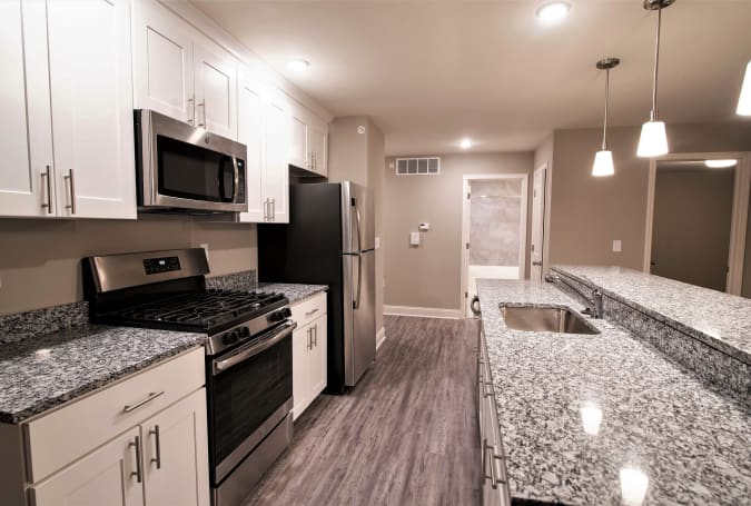Fully equipped kitchen with stainless steel appliances at Enclave 50 in Ballston Spa, New York