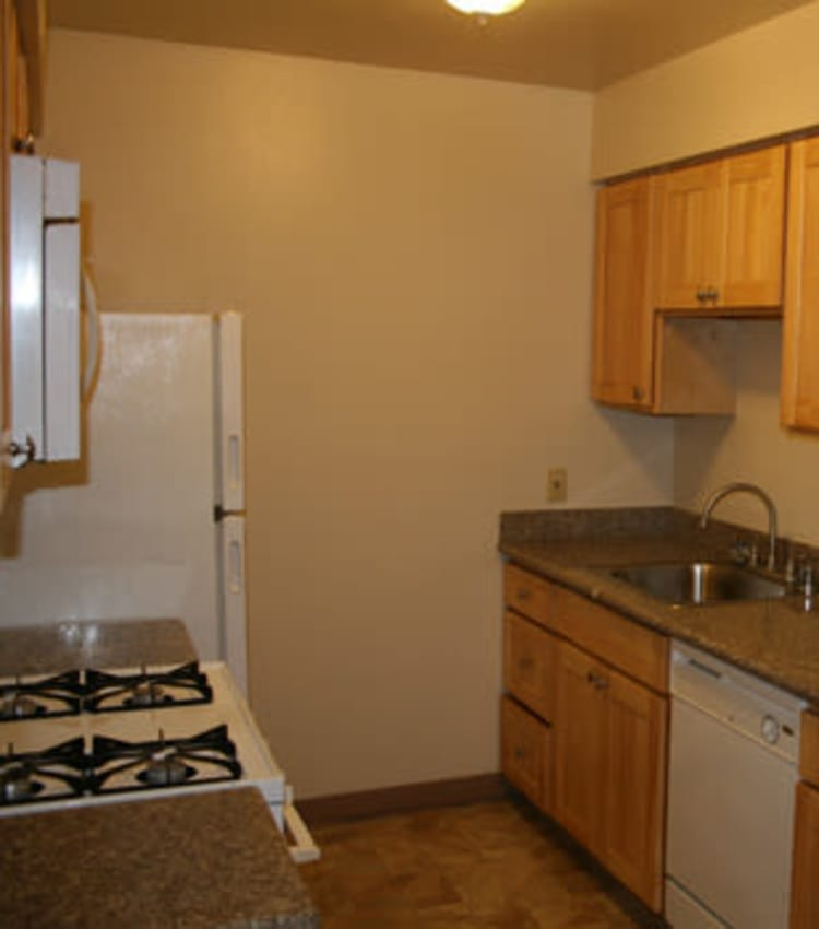 Well equipped kitchen at San Tropez Apartments in Fresno, CA